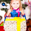 A girl under the Christmas tree with gifts — Foto Stock