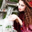 Beautiful gypsy girl in red dress — Stock Photo #11279508