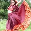 Foto de Stock  : Beautiful gypsy girl in red dress