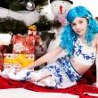 A girl lying under a Christmas tree — Stock Photo