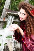 Beautiful gypsy girl in red dress — Stock Photo