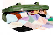 Girl hidden in a suitcase — Stock Photo