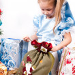 Girl gets a Christmas present — Stock Photo #11456807