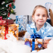 Girl gets a Christmas present — Foto de Stock