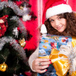 Girl gets a Christmas present — Stock Photo