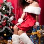 Girl gets a Christmas present — Stock Photo #11514518