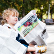 Stock Photo: Girl reading newspaper.