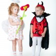 Boy in image of devil and girl angel — Stock Photo #11514745