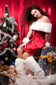 Girl gets a Christmas present — Stock Photo