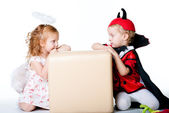 The boy in the image of devil and a girl angel — Stock Photo