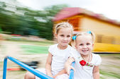 Kids rotate on a carousel — Stock Photo