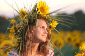 Beautiful girl with sunflower — Stock Photo