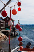 Fishing equipment hanging in a small fishing village — Stock Photo