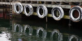 Row of old tyres to protect boats — Stock Photo