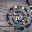 Vintage buttons on old wooden table - Foto Stock
