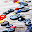 Vintage buttons on old wooden table — Foto Stock