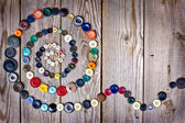 Vintage buttons on old wooden table — 图库照片