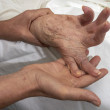 Foto Stock: Arthritic Hand