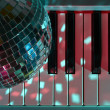 Disco ball and keyboard — Stock Photo #11534275