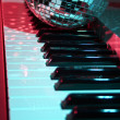 Disco ball and keyboard — Stock Photo