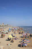 Mediterranean beach crowded with tourists — Stock Photo