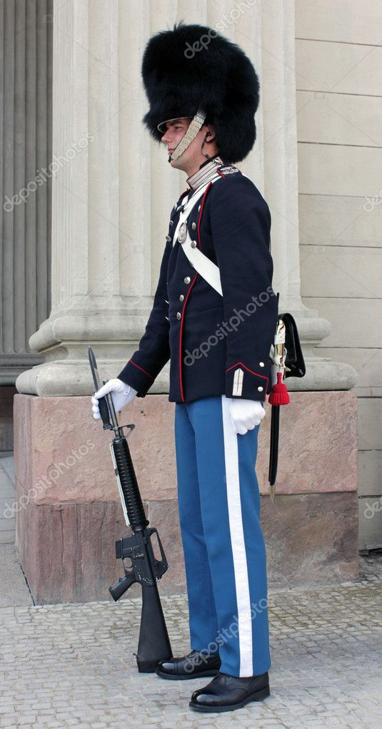 DENMARK, COPENHAGEN - MAY 15: A Danish soldier guarding  Amalienborg Palace at May 15, 2012. This palace is the Danish Royal residence and a top tourist attraction as well.  Stock Photo #10826678
