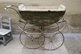 Old baby carriage — Stock Photo