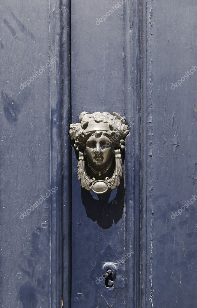 Old blue door, detail of a door knocker and lock  Stock Photo #12139892