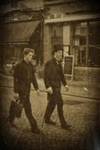 Vintage photo of two men in Bruges, Belgium — Stock Photo