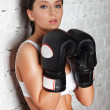 Portrait of sexy boxer girl with gloves on hands — Stock Photo #11607435