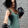 Portrait of sexy boxer girl with gloves on hands — Stock Photo