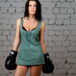 Stock Photo: Portrait of sexy boxer girl with gloves on hands