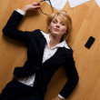 Beautiful blonde young businesswoman lying on floor — Stock Photo