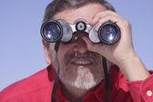 Man searching with Binoculars — Stock Photo