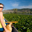 Woman in a canoe with her dog — Stock Photo
