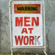 Stock Photo: Men at Work Sign