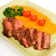 Flank Steak with mashed sweet potato - Stock Photo