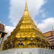 Stock Photo: Golden Chedi with demons