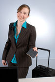 Smiling Business Woman at Check-in — Stock Photo