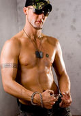 Sexy Serious Gay Guy with Handcuffs — Stock Photo