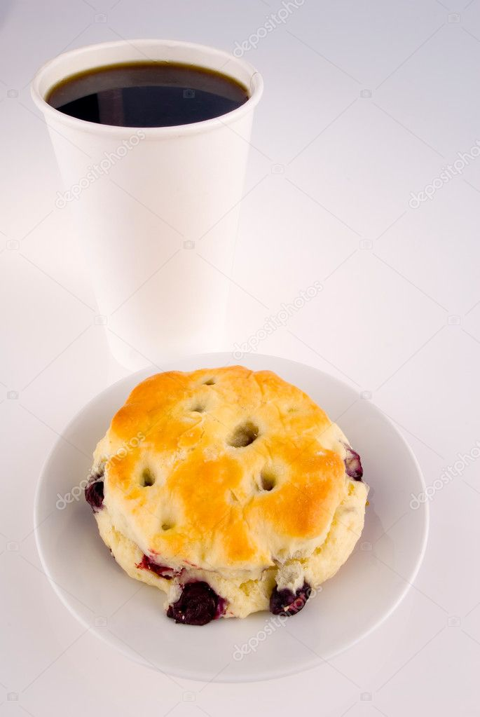 This image shows a Blueberry Scone and Take-out Coffee  Stock Photo #11001936