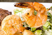Steak and Seafood with caesar salad — Stock Photo