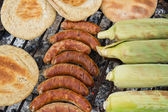 Outdoor Barbeque with smokies — Stock Photo