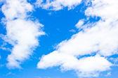 Beautiful cloudscape on sunny blue sky — Stock Photo