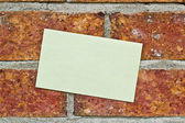 Yellow Note On brick wall — Stock Photo