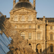 PARIS,FRANCE - June 16: The large pyramid in Louvre and facade of Pavillon Sully in sunset light on June 16, 2011 in Paris. Pavillon Sully was built between 1624 and 1654 under King Louis XIV. - Stock Photo