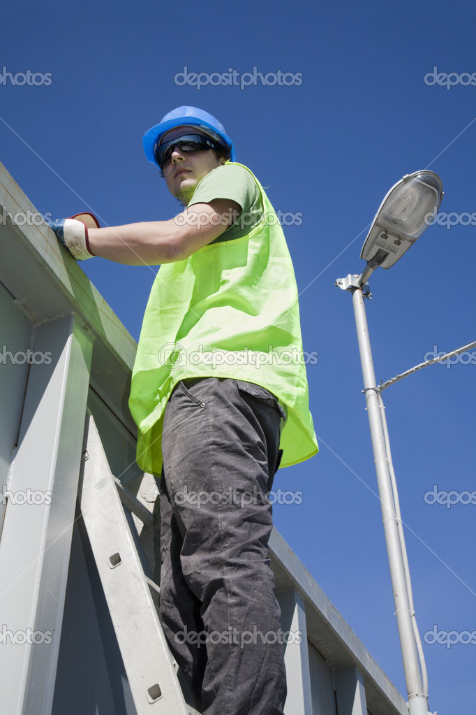 Young worker on the ladder — Stock Photo #10740800