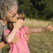 Grandmother and grandchild at play — Stock Photo