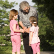 Stock Photo: Grandmother and grandchilds - dialog
