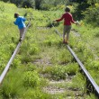 Children and old rails — Stock Photo